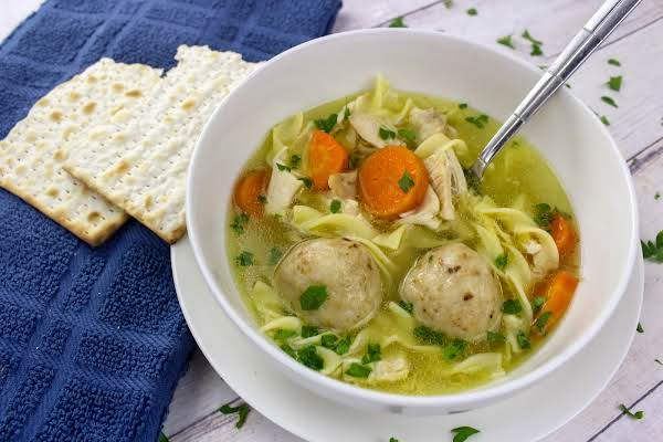 Traditional Hard Matzo Ball Soup In A Bowl.