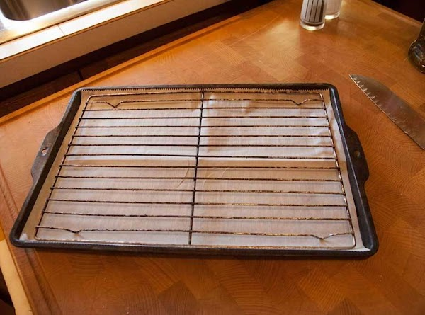 Place a piece of parchment paper in the bottom of a baking tray, and...