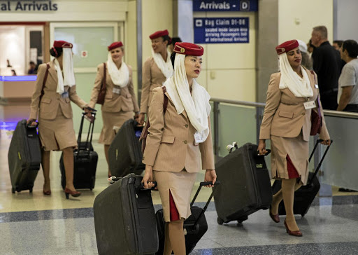 Emirates Airlines flight attendants come through the international arrivals gate from Dubai at Dallas/Fort Worth International Airport in Texas. Picture: REUTERS