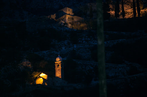 Kotor-trail-at-twilight.jpg - As night descends, lights cast a glow on key monuments along the centuries-old trail called the Ladder of Kotor.