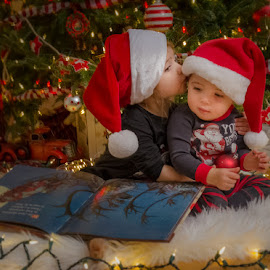 Christmas Kiss by Chris Cavallo - Public Holidays Christmas ( book, christmas tree, tree, portrait, kiss, christmas, santa, low light, red, ornament, white, kissing, hat, lights,  )