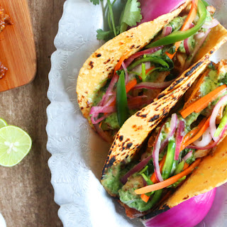 Spicy Broiled Chicken Tacos with Cilantro Sauce and Carrot-Onion Salad.