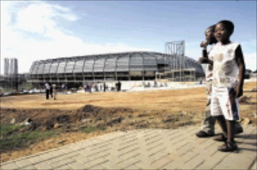 NEW - LOOK: Sowetans, young and old, are having a glimpse of the rebuilt Orlando Stadium.  18/11/2008. Pic. Antonio Muchave.  © Sowetan