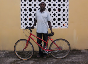 Photo: Emmanuel is from Ghana and lives at the end of a wretched gravel road 18 km. from the main coastal highway. Emmanuel is a rubber tapper at the commercial farm 3 miles from his home.