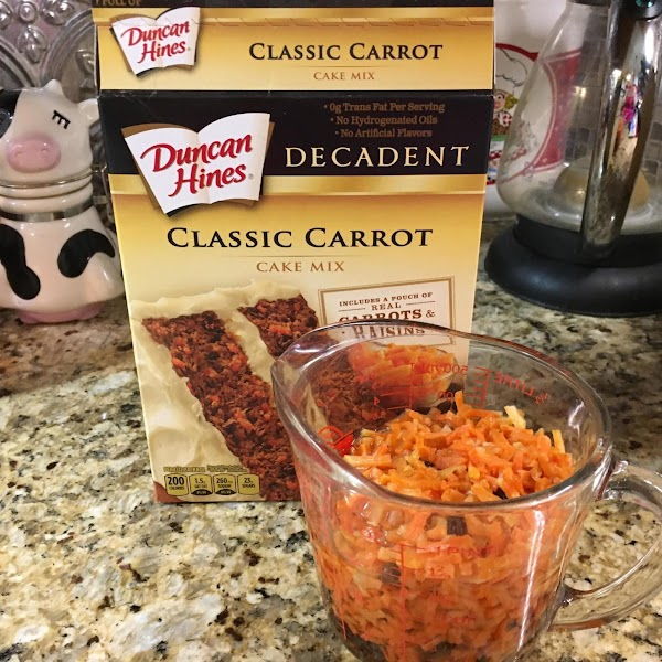 open cake box and remove the pouch of dehydrated carrots and raisins and follow...