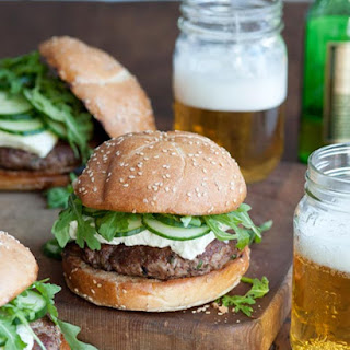 Lamb Burger with Arugula, Feta & Cucumbers.