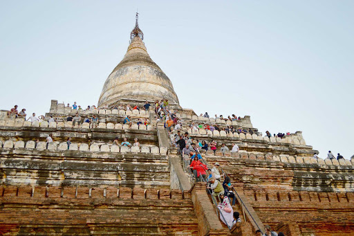pagoda-visitors - A nearly vertical climb to the top of one of the many temples in Bagan.  Perfect for sunset watching.