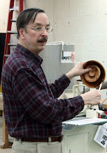 Photo: Gary Guenther demonstrates results from using the Sorby Slicer tool to core a cherry blank to get two bowls instead of one.