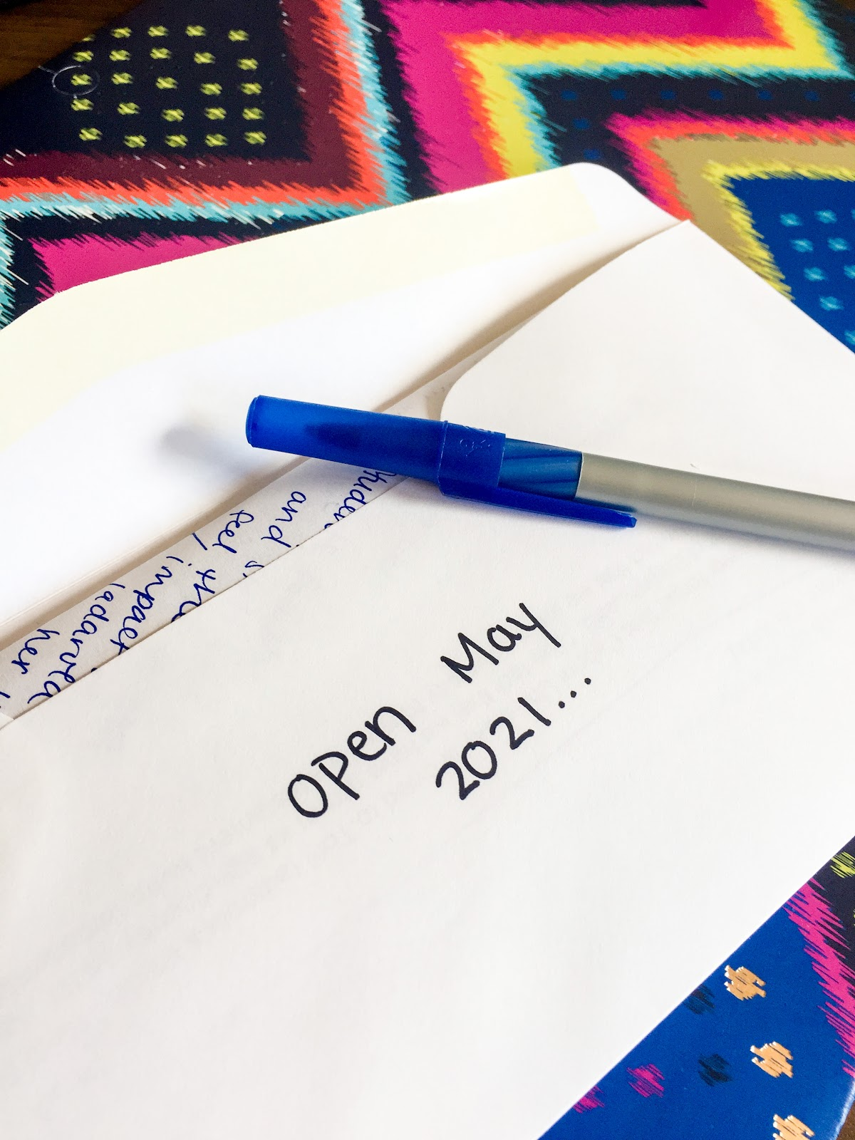"Envelope with writing on it that reads ""Open May 2021"""