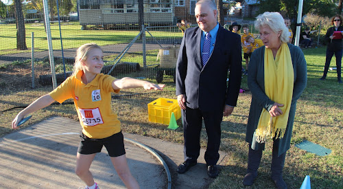 Local little athlete Molly Crocket offers some discus tips to Narrabri High School principal Dinos Charalambous and Narrabri Shire Mayor Cathy Redding at Narrabri Little Athletics' first competition day yesterday afternoon.