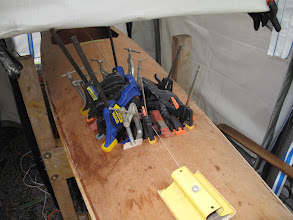 Photo: all hands aboard, gang of clamps in aid of stacked-underside hatch cover mount application
