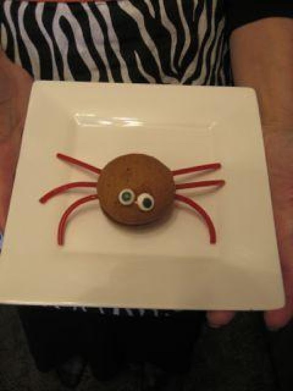 TIPS: To make the spiders, just add shoestring liquorice pieces between the layers. Stick...