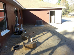 Photo: December 19, 2012 The pool plumbing looked a bit mysterious at first, but I learned it's really pretty straightforward. The door leads into the garage where other contractors are busy with HVAC and still others work on the water infrastructure.