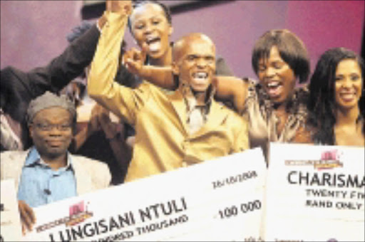 WINNER: Lungisani Ntuli with his  R100 000 prize money after winning SABC2's music reality show I Want To Sing Gospel.Pic. Veli Nhlapo. 23/10/20108. © Sowetan