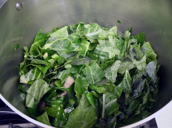 Stir collard greens into the pot, and bring to a boil.