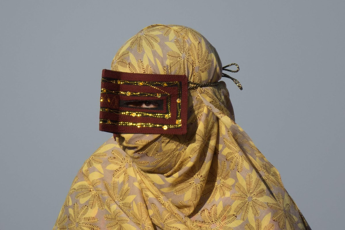 Hormuz Island Guide: Travel Tips & Things To See // Bandari woman wearing the traditional boregheh mask