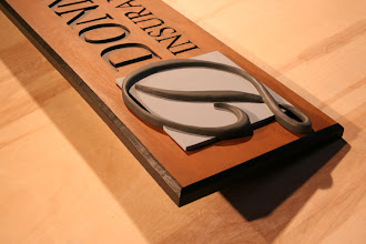 Photo: Donnelly Insurance GroupCustom Carved Wood Sign by Melissa Jones www.NiceCarvings.com