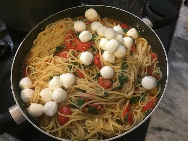 Strain the mozzarella balls and add to the pasta.  Toss together to coat pasta.