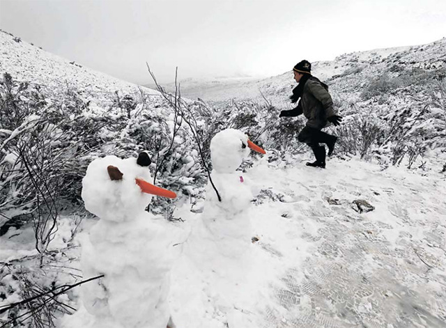A child plays in the snow on the Swaarmoed Pass, 10km outside Ceres in the Western Cape earlier this year.