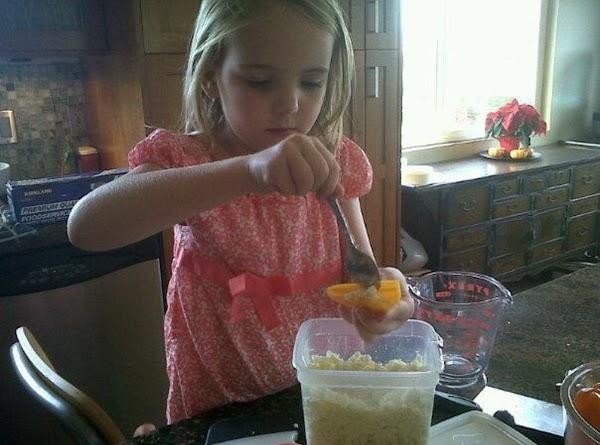 spoon feta cheese into each pepper half.(this is Abigail.)