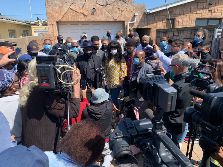 Police minister Bheki Cele addresses the media alongside Lt-Col Charl Kinnear's wife, Nicolette, a day after the detective was shot dead on September 18 2020 outside his home in Bishop Lavis, Cape Town.