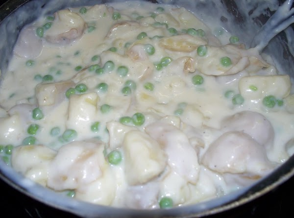 mix the white sauce with the pea's and potatoes.