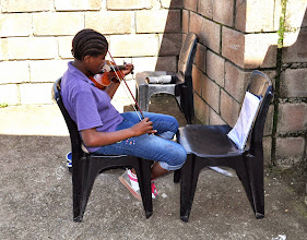 """Photo: Esther practicing """"Amazing Grace"""" which she performed during the celebration."""