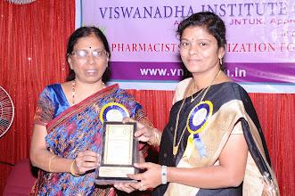 Photo: Dr. M. Savithri, Organizing Secretary honoring Dr. M. Aruna Devi - Guest of Honor