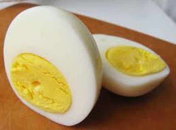 Slice each egg in half lengthwise.  Once all are sliced, carefully pull out...