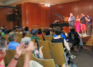 Photo: Host Gary Glazner, singer Hannah Reimann, NYMC Executive Director Christopher Nadeau and Program Director Josephine Brown introduce the program.