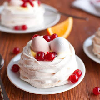 Meringue Nests With Orange Curd Cream and Easter Eggs.