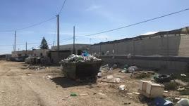 Entrada al asentamiento en Las Chozas.