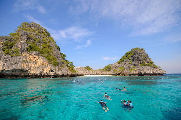 Stop at Koh Ha for swimming in turquoise water
