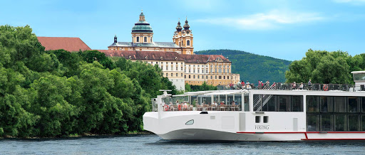 Viking Kara passes a historic abbey in the quaint Austrian city of Melk  along the banks of the Danube River.