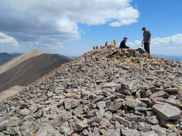 Hikers atop Sunshine Peak