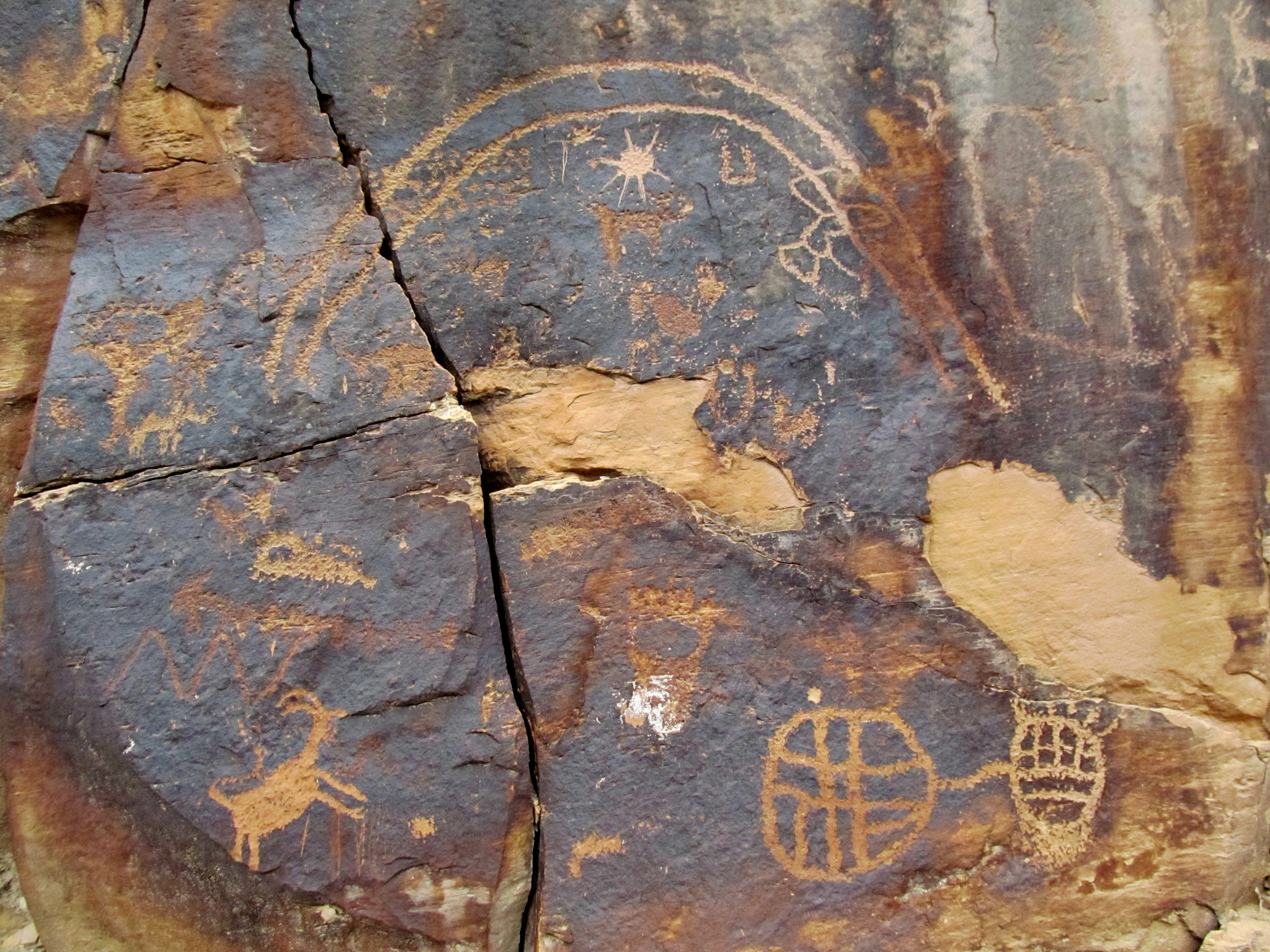 Photo: An arc and other petroglyphs