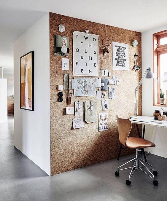creative studio space in home office leather chair corkboard wall creative inspiring