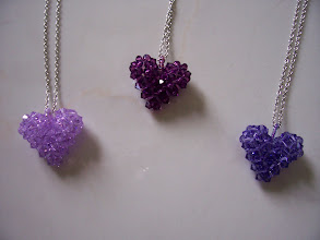 "Photo: Swarovski Crystal Heart. Size: 1"" x 1"" face and 1/2"" thick with 18"" chain. Color left to right: Violet, Amethyst and purple. $35.00 each."