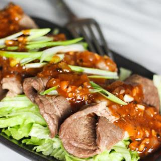 Sliced Beef Over Lettuce.