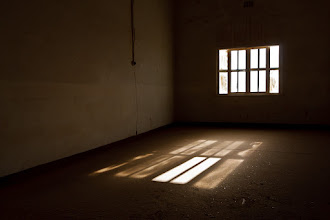 Photo: Inside the barracks at Kolmanskop ghost town, Namibia.