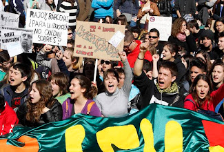 """Photo: Students shout slogans during a demonstration against the Spanish government's new education policy and alleged corruption cases, on the second day of a three-day long nationwide strike in public secondary education, in Valencia February 6, 2013. The placards read,"""" Wert (education minister) dismissal (L)"""", """"Rajoy, Barcenas, did you leave some envelopes for education?"""" (C) and """"Shame, no to the new law.""""    REUTERS/Heino Kalis (SPAIN - Tags: POLITICS CIVIL UNREST EDUCATION)"""