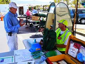 Photo: Jerry (KT6CRT) explaining ARES and CERT to a visitor.