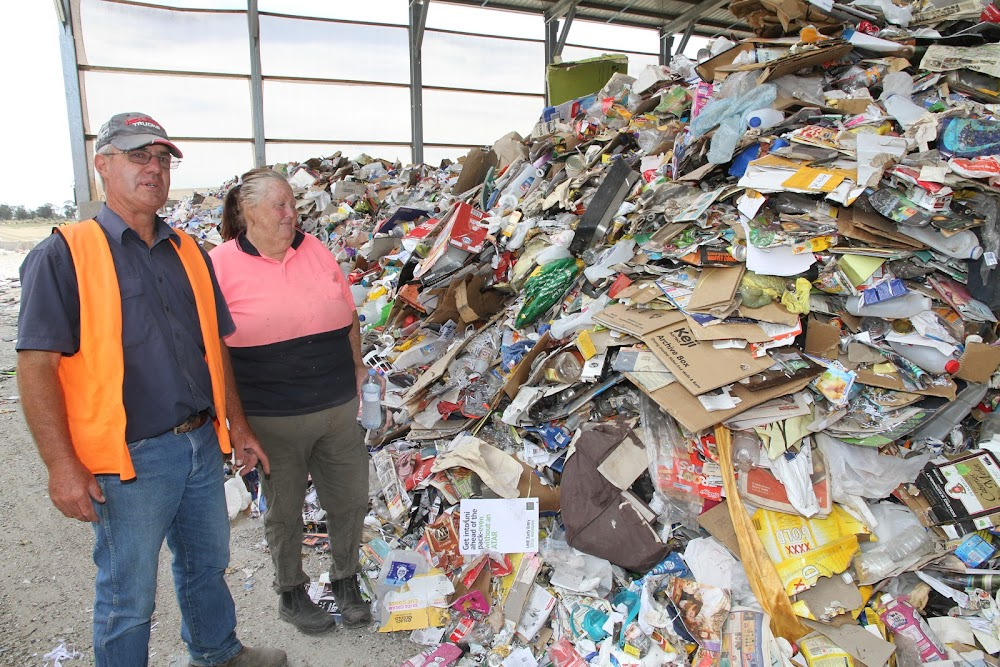 Challenge supervisor John Pattison and employee Marie Hatch survey just some of the tonnes of recyclable materials which arrive for processing at Challenge.