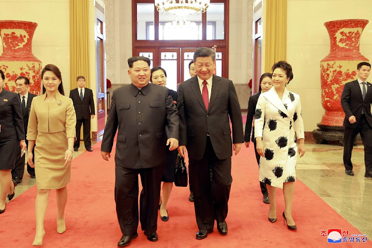 North Korean leader Kim Jong-un (centre left) and wife, Ri Sol-ju, (far left) with Chinese President Xi Jinping (centre right) and wife Peng Liyuan walk together during an unofficial visit to Beijing, China, March 28 2018. Picture: REUTERS