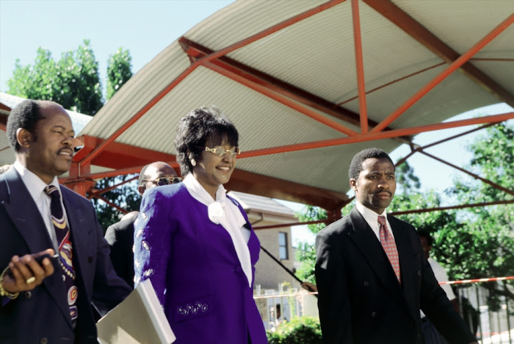 "Winnie Madikizela-Mandela at the Truth and Reconciliation Commission (TRC) hearings. In its final report in 1998, the TRC ruled that Madikizela-Mandela was ""politically and morally accountable for the gross violations of human rights committed by the Mandela United Football Club""."