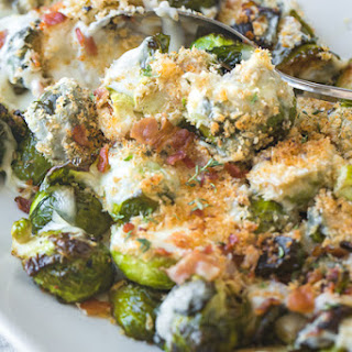 Roasted Brussels Sprouts with Creamy Parmesan Sauce and Bacon.