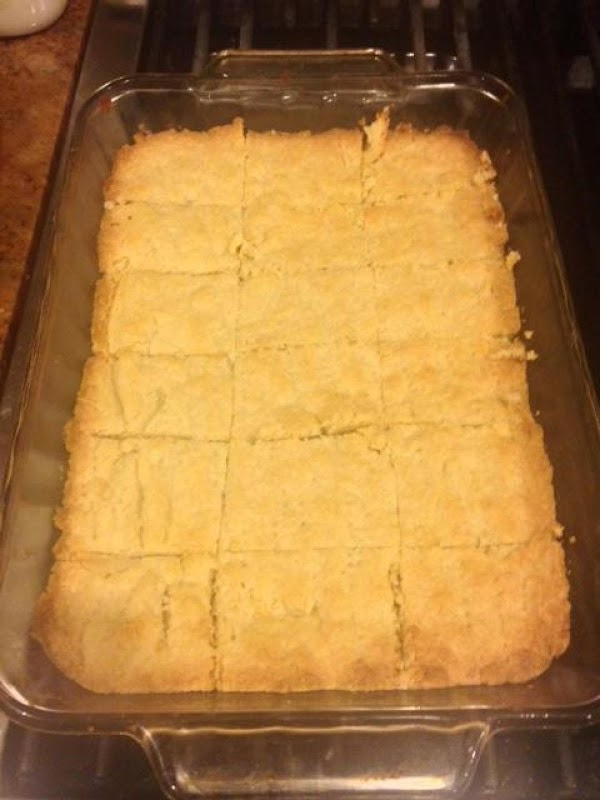 Remove shortbread from oven and immediately cut into squares. Let cool and then sprinkle...