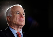 FILE PHOTO -  U.S. Republican presidential nominee Senator John McCain (R-AZ) listens as he is being introduced at a campaign rally in Denver, Colorado October 24, 2008.