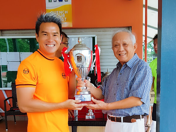 Coach XT receiving the STA Inter-Club Tennis Tournament Doubles Knock-Out Overall Champion Challenge Trophy from Singapore Tennis Association President Nicholas Lim on behalf of TNT Tennis Club.
