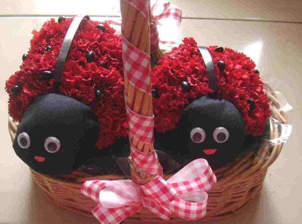 Now, we make the faces of the ladybirds.  Take a pair of doll's eyes and...